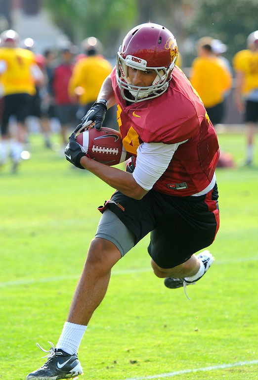 . USC WR Christian Guzman secures a pass during practice, Tuesday, March 25, 2014, at USC. (Photo by Michael Owen Baker/L.A. Daily News)