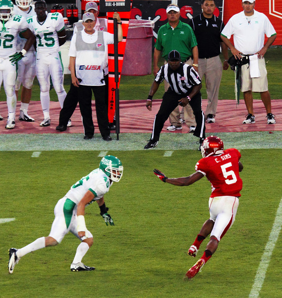 Sims dodging a UNT tackler