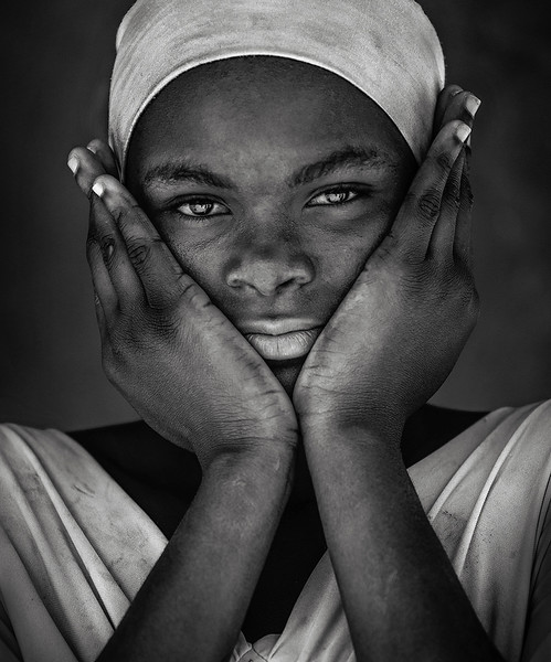 Black and white portrait of a young lady in a tiny fishing village south of Pangani.  Pangani, Tanzania, 2019