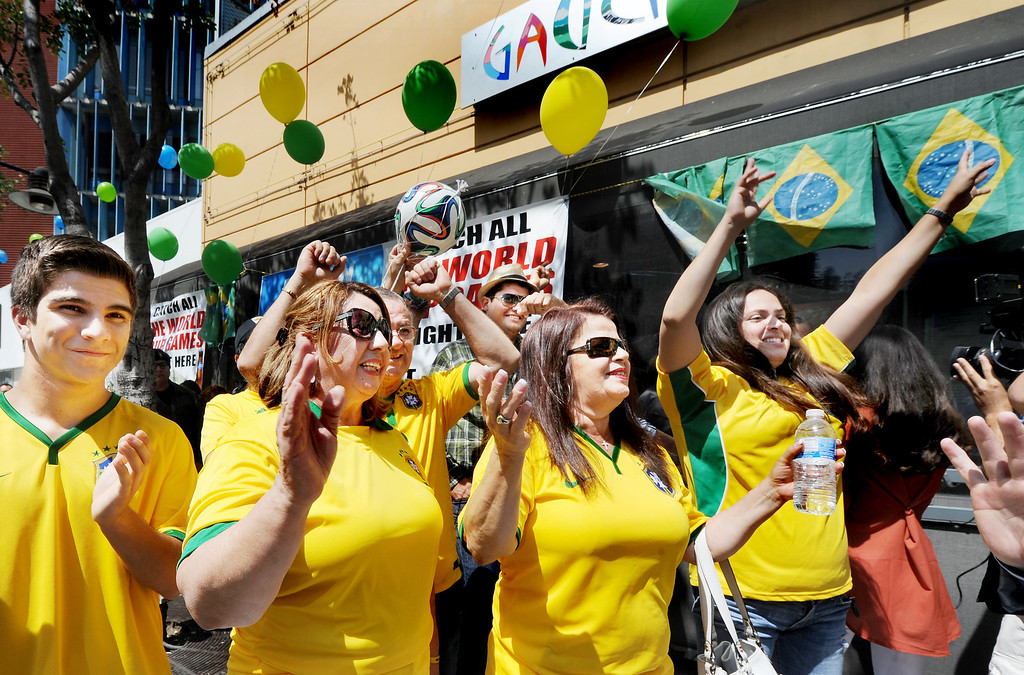 . Brazilian fans showed up at Gauchos Village, a Brazilian style restaurant in Glendale to party and watch live television broadcast  of World Cup action between Brazil and Croatia in the World Cup Thursday, June 12, 2014.(Photo by Walt Mancini/Pasadena Star-News)
