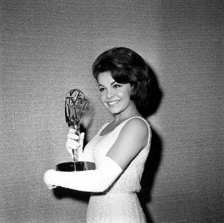 """. Former Mouseketeer Annette Funicello accepts on behalf of Walt Disney studios the Emmy for best children\'s programming, \""""Walt Disney\'s Wonderful World of Color,\"""" at the Emmy Awards ceremony in Hollywood, Calif., on May 26, 1963.    (AP Photo)"""