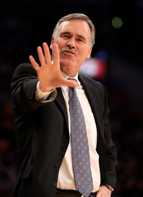 . Head coach Mike D\'Antoni of the Los Angeles Lakers complains to a referee in the game with the Denver Nuggets at Staples Center on January 6, 2013 in Los Angeles, California.   (Photo by Stephen Dunn/Getty Images)