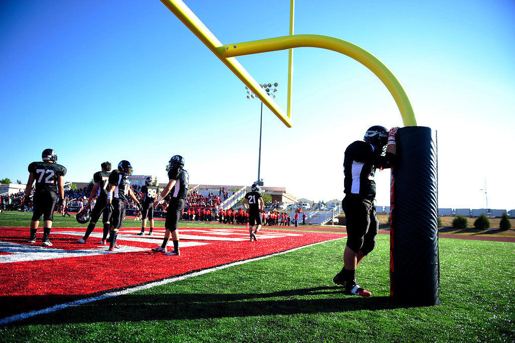 . Cheyenne Central\'s Zack Rose takes a moment before playing Cheyenne East. East won 42-28 at Central\'s Riske Field on Friday, September 14, 2012. AAron Ontiveroz, The Denver Post