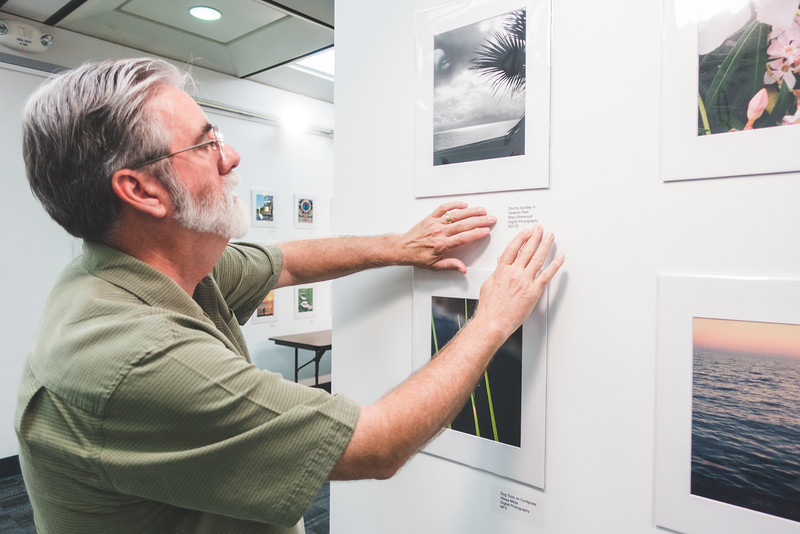 Jeffrey Janko puts the finishing touches on the submissions for the Phone Photography Show in the Mary and Jeff Bell Library.