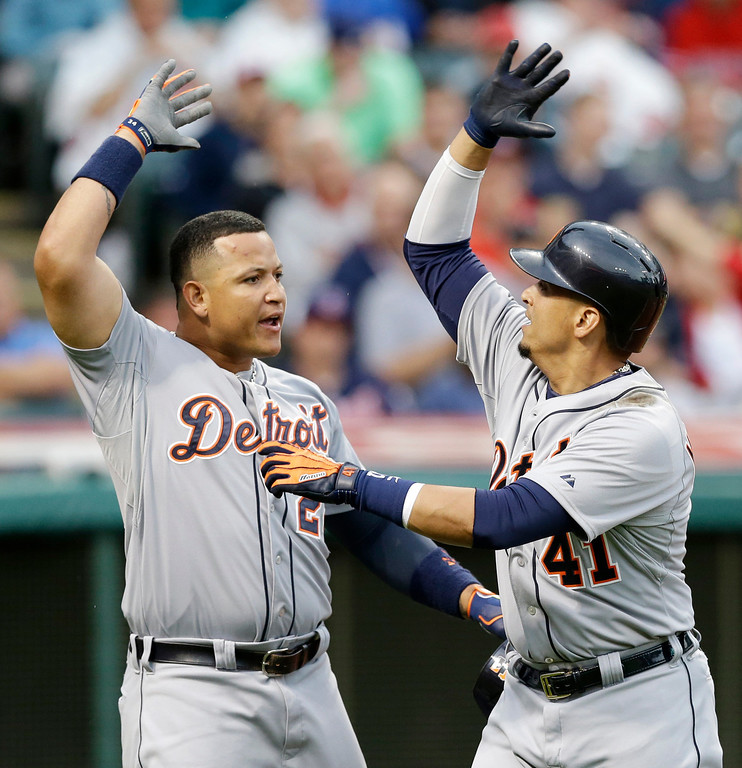 . Detroit Tigers\' Miguel Cabrera, left, and Victor Martinez celebrate after Martinez hit a two-run home run off Cleveland Indians starting pitcher Corey Kluber in the fourth inning of a baseball game on Friday, June 20, 2014, in Cleveland. Both scored on the hit. (AP Photo/Tony Dejak)