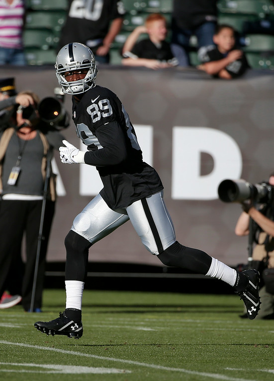 . Oakland Raiders wide receiver James Jones (89) warms up before an NFL preseason football game against the Detroit Lions in Oakland, Calif., Friday, Aug. 15, 2014. (AP Photo/Marcio Jose Sanchez)