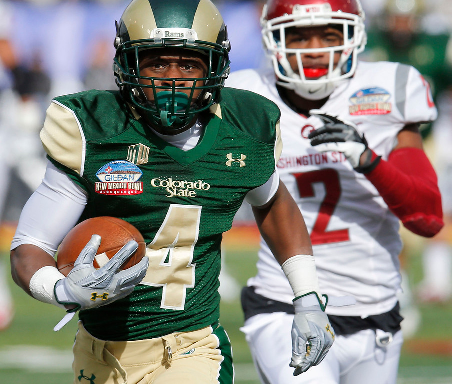 . Colorado State wide receiver Charles Lovett (4) runs in a touchdown after the reception as Washington State cornerback Nolan Washington (2) defends during the first half of the New Mexico Bowl NCAA college football game, Saturday, Dec. 21, 2013, in Albuquerque, N.M. (AP Photo/Matt York)