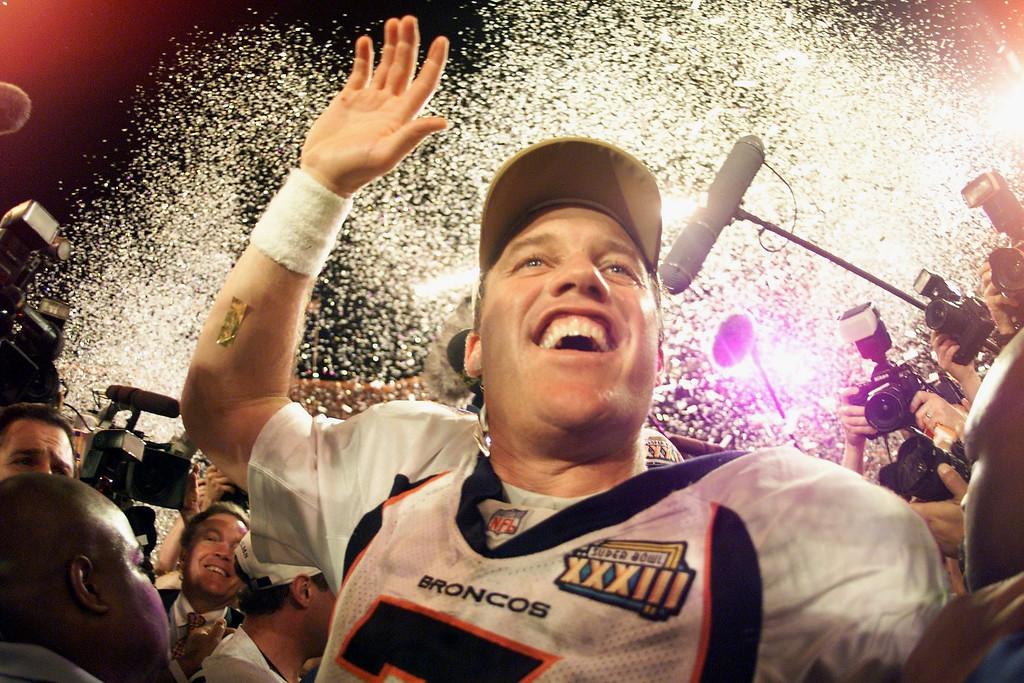 . Denver Broncos John Elway celebrates his second  Super Bowl victory as the Broncos beat the Atalanta Falcons in  Super Bowl XXXIII at Pro Player Stadium. (John Leyba/The Denver Post)