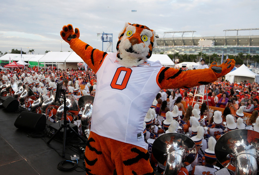 . A Clemson mascot performs on stage for fans before the Orange Bowl NCAA college football game between Clemson and Ohio State, Friday, Jan. 3, 2014, in Miami Gardens, Fla. (AP Photo/Lynne Sladky)