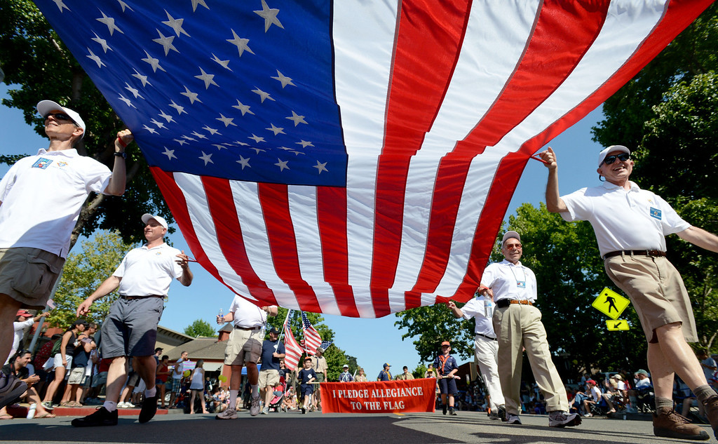 . Members of Danville\'s Knights of Columbus, all combat veterans, carry a large flag during the 4th of July Parade in Danville, Calif., on Thursday, July 4, 2013. The parade, sponsored by the Kiwanis Club of San Ramon Valley, features about 120 entries with an estimated 40,000 spectators attending. (Doug Duran/Bay Area News Group)