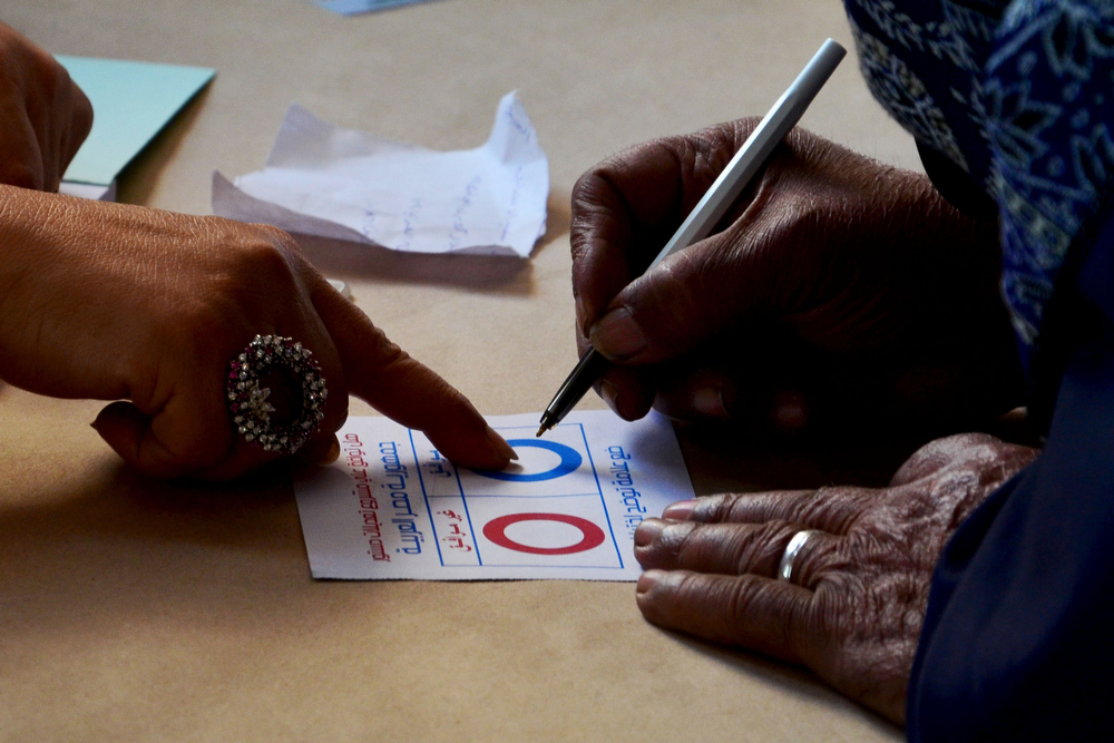 . A woman fills in a ballot paper as she votes on a new constitution at a polling station in the coastal Egyptian city of Alexandria on January 14, 2014 during the vote. (MOHAMED ABDELAZIZ/AFP/Getty Images)