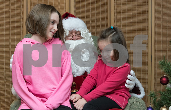 11/27/17 Wesley Bunnell   Staff Santa and Mrs. Claus visited the Berlin Recreation Center on Monday evening as guests from Berlin Parks & Recreation. Mya Kelly, age 9, and Ava Kelly, age 4, sit on Santa's lap and give their Christmas list.