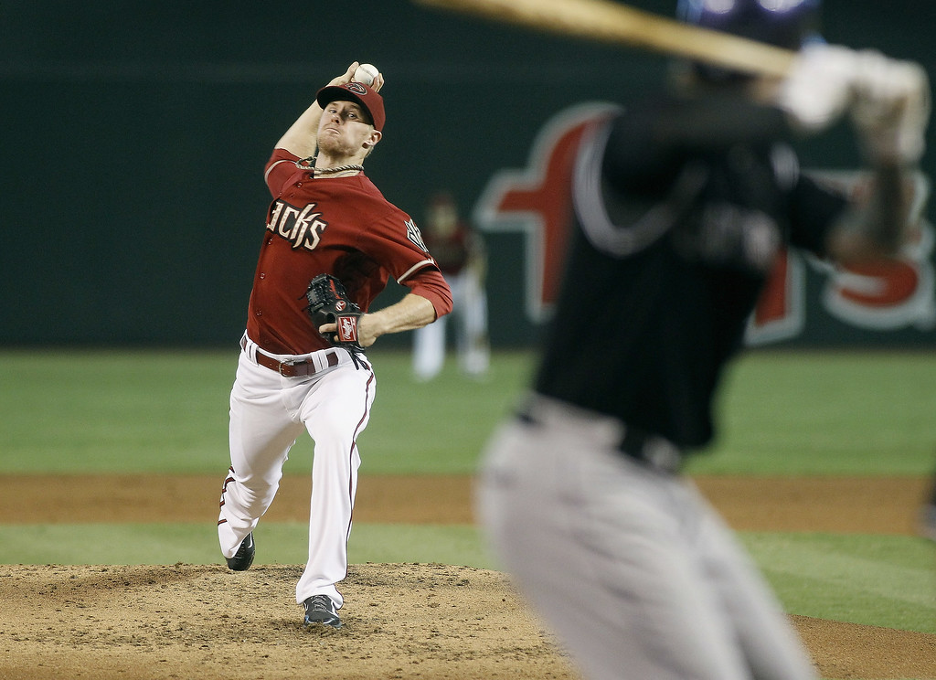 . Starting pitcher Chase Anderson #57 of the Arizona Diamondbacks delivers a pitch against the Colorado Rockies during the third inning of a MLB game at Chase Field on August 31, 2014 in Phoenix, Arizona.  (Photo by Ralph Freso/Getty Images)