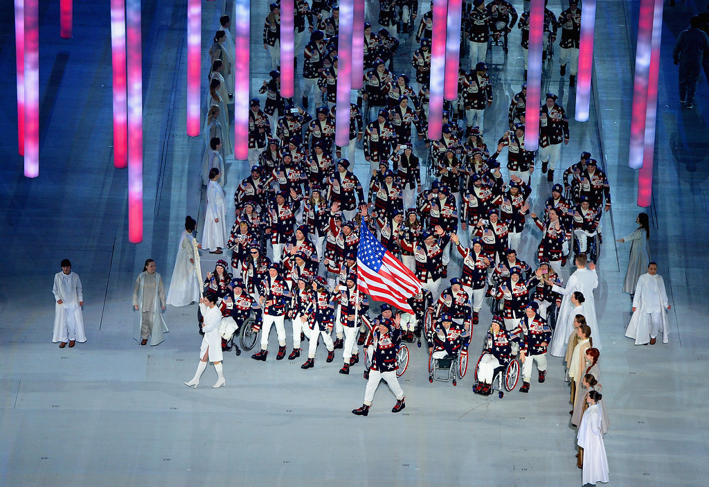 . Jonathan Lujan of United States carries the flag during the Opening Ceremony of the Sochi 2014 Paralympic Winter Games at Fisht Olympic Stadium on March 7, 2014 in Sochi, Russia.  (Photo by Dennis Grombkowski/Getty Images)