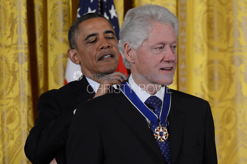 President Barack Obama awards the Presidential Medal of Freedom to former President Bill Clinton.