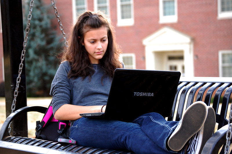 Student studying on a fall afternoon in the Quad.