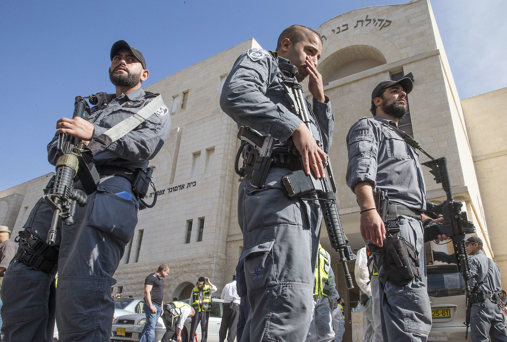 . Israeli security personnel stand outside a synagogue that was the scene of an attack, by two Palestinians, on Israeli worshippers in the ultra-Orthodox Har Nof neighborhood  in Jerusalem on November 18, 2014. Two Palestinians armed with a gun and axes burst into a Jerusalem synagogue and killed four Israelis before being shot dead, in the deadliest attack in the city in years. AFP PHOTO /JACK GUEZ/AFP/Getty Images