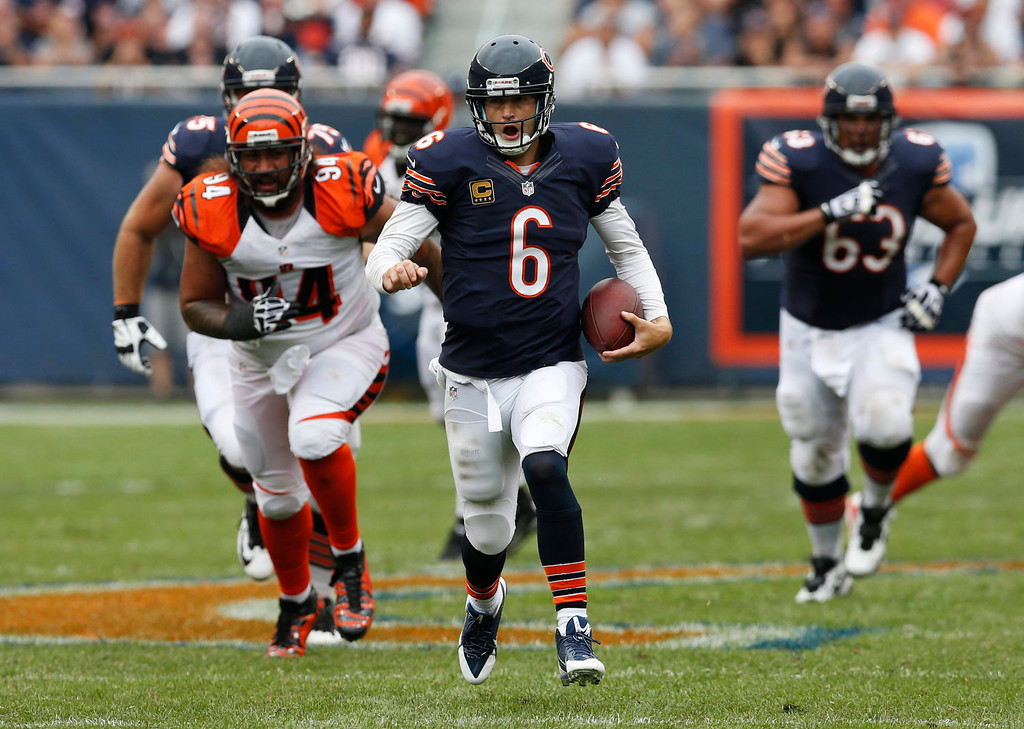 . Chicago Bears quarterback Jay Cutler (6) rushes for yardage against the Cincinnati Bengals during the second half of an NFL football game, Sunday, Sept. 8, 2013, in Chicago. The Bears won 24-21. (AP Photo/Charles Rex Arbogast)