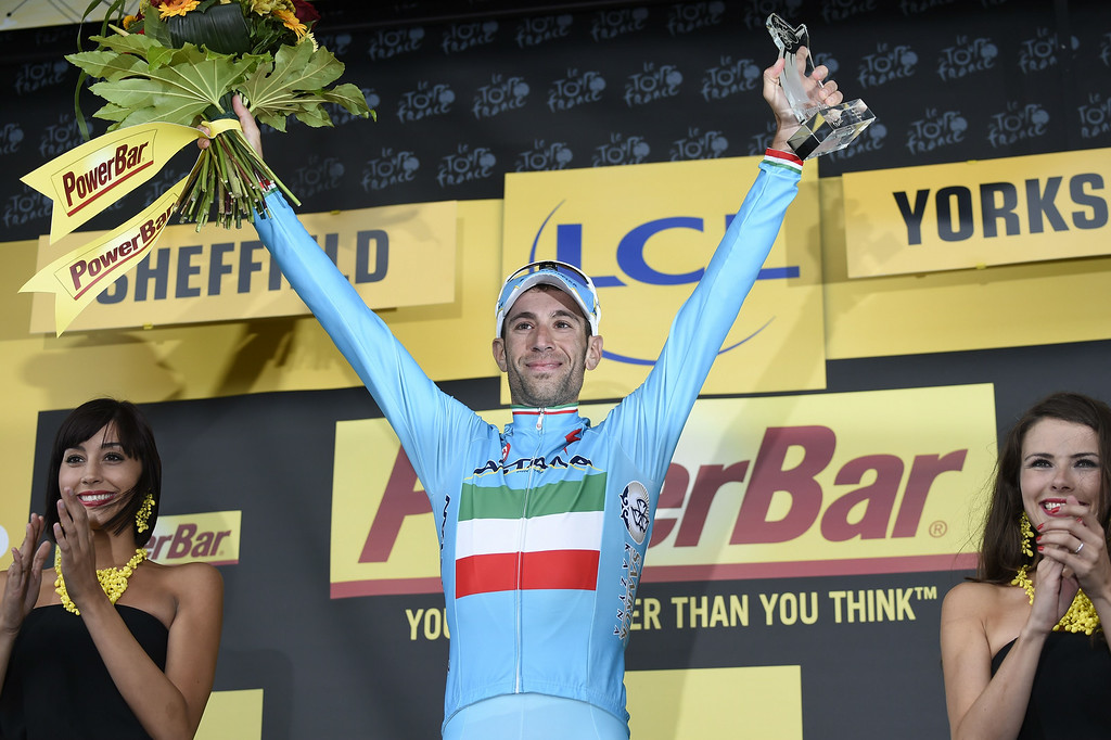. Stage winner Italy\'s Vincenzo Nibali celebrates on the podium after winning the 201 km second stage of the 101th edition of the Tour de France cycling race on July 6, 2014 between York and Sheffield, northern England.  AFP PHOTO / ERIC FEFERBERGERIC FEFERBERG/AFP/Getty Images