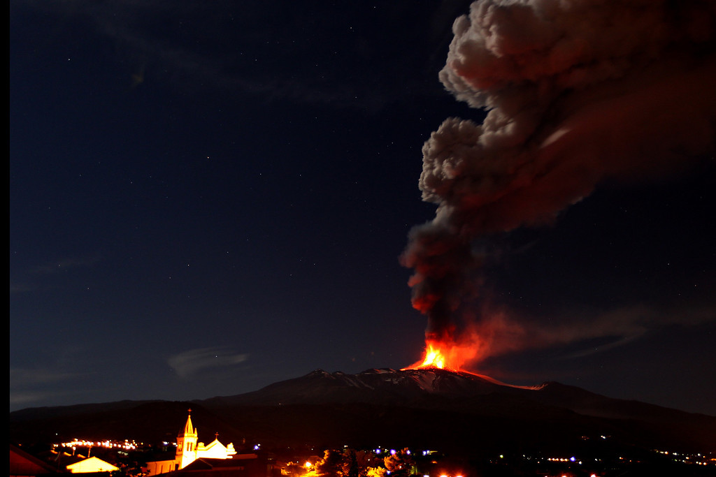 . Mt. Etna, Europe\'s most active volcano, spews lava as smoke billows during an eruption as seen from Acireale, near the Sicilian town of Catania, Italy, Saturday, Nov. 16, 2013. (AP Photo/Carmelo Imbesi)