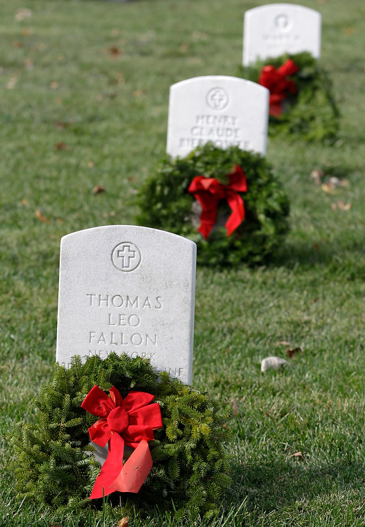 . Wreath adorn headstones during Wreaths Across America\'s 150th anniversary, Saturday, Dec. 13, 2014, at Arlington National Cemetery in Arlington, Va. (AP Photo/Luis M. Alvarez)