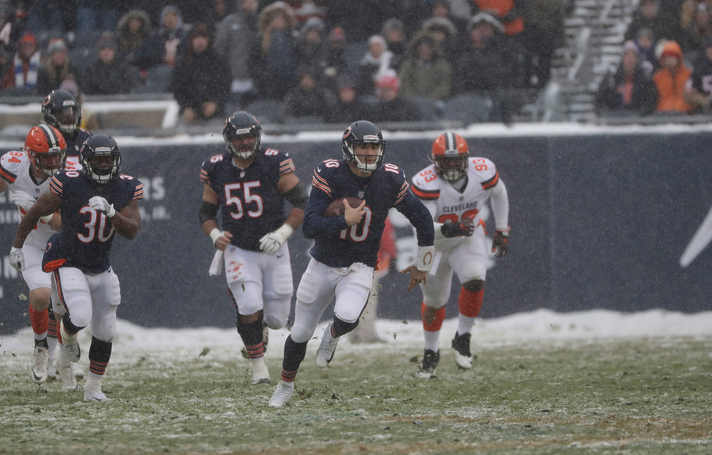 . Chicago Bears quarterback Mitchell Trubisky (10) runs against the Cleveland Browns in the first half of an NFL football game in Chicago, Sunday, Dec. 24, 2017. (AP Photo/Nam Y. Huh)