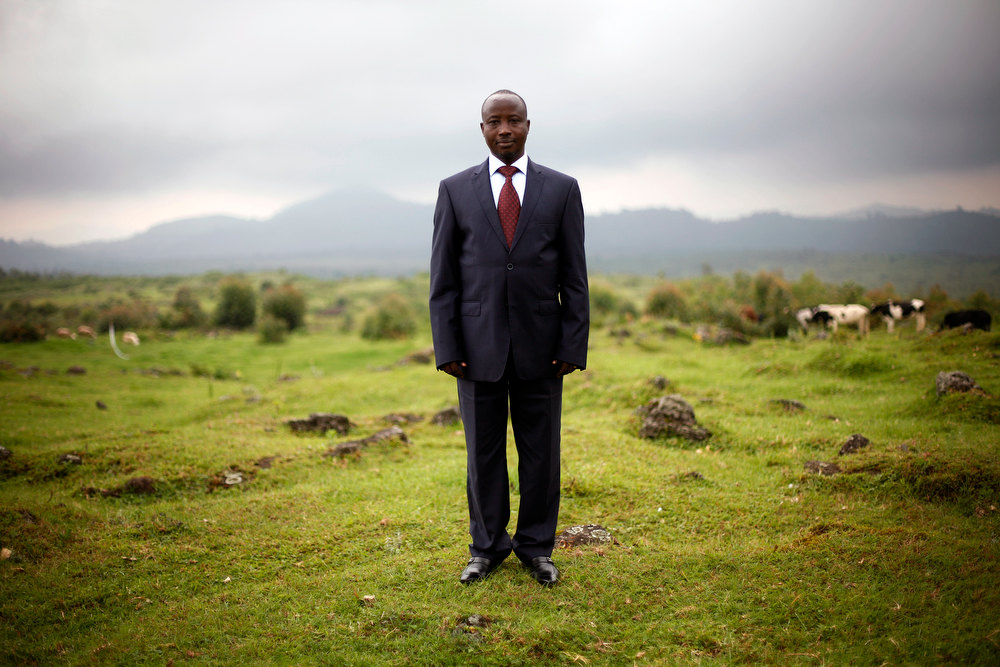 . Congolese M23 rebel president Jean Marie Runiga  poses for a portrait at his hideout near the Congo-Uganda border town of Bunagana Wednesday Dec. 5 2012. Speaking to the Associated Press, Runiga said they would not accept for the Kinshasa government to pay the M23 expenses at the scheduled Kampala talks later this week, as the two are still in a belligerent state. M23 rebels completed their withdrawal from the strategic eastern city of Goma  on Saturday, in compliance with an agreement reached between the rebel group and a regional body, they could still be seen in positions three kilometers from Goma airport. (AP Photo/Jerome Delay)
