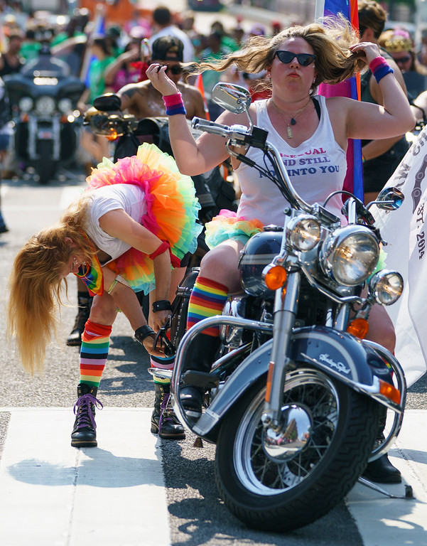 """. Sarah Massey, right, \""""Sergeant of Hotness\"""" of the Out Riders Women\'s Motorcycle Club, and her passenger Lacy MacAuley prepare to ride in the Capital Pride Parade in Washington, Saturday, June 9, 2018. The yearly event is hosted by and in support of the LGBTQ+ community and moves through the Dupont Circle and Logan Circle neighborhoods of Washington. (AP Photo/Carolyn Kaster)"""