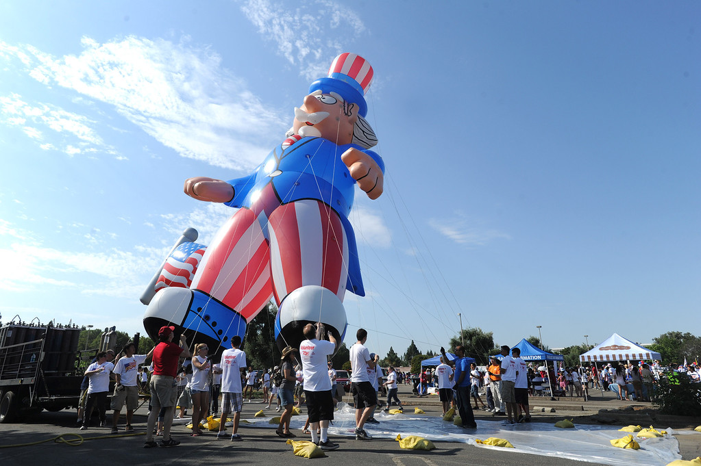 . Volunteers practice maneuvering a large inflated figure just prior to the start of the Fourth of July parade in Fremont, Calif., on Thursday, July 4, 2013. The parade featured more than 70 entries. (Dan Honda/Bay Area News Group)