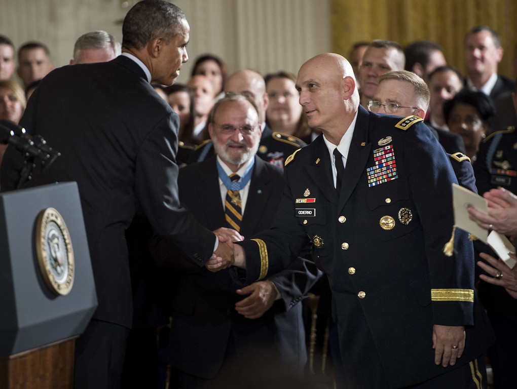 . US President Barack Obama shakes Army Chief of Staff Ray Odierno\'s hand after a Medal of Honor ceremony in the East Room of the White House May 13, 2014 in Washington, DC. Obama awarded the medal to former US Army Sergeant Kyle J. White  for his actions in Aranas, Afghanistan in 2007. AFP PHOTO/Brendan SMIALOWSKI/AFP/Getty Images