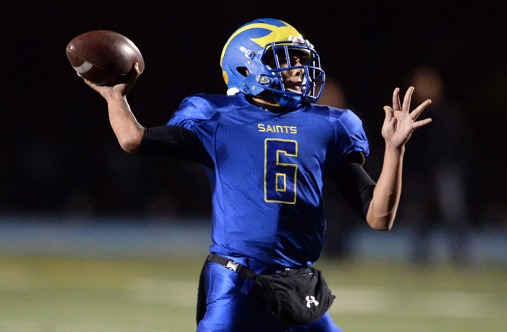 . San Dimas quarterback Josh Avila passes against Paraclete in the first half of a CIF-SS Mid-Valley Division championship football game at San Dimas High School in San Dimas, Calif., on Friday, Dec. 6, 2013.   (Keith Birmingham Pasadena Star-News)