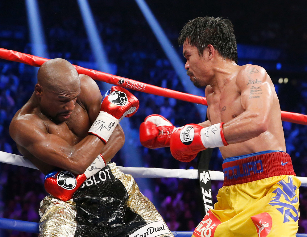 . Manny Pacquiao, from the Philippines, right, trades blows with Floyd Mayweather Jr., during their welterweight title fight on Saturday, May 2, 2015 in Las Vegas. (AP Photo/John Locher)