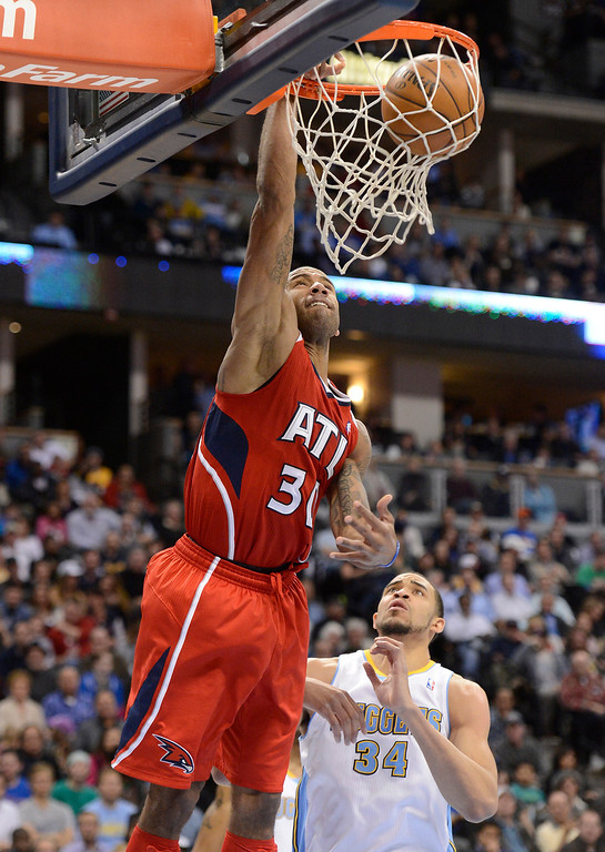 . Dahntay Jones (30) of the Atlanta Hawks goes up for an easy dunk past JaVale McGee (34) of the Denver Nuggets during the third quarter March 4,  2013 at Pepsi Center. The Denver Nuggets defeated the Atlanta Hawks 104-88. (Photo By John Leyba/The Denver Post)