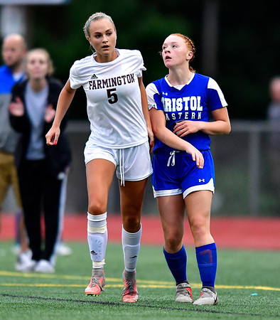 9/12/2019 Mike Orazzi | StaffrFarmington's Rylee Fountain (5) and Bristol Eastern's Lili Morneault (7) during girls soccer under the lights on Thursday at Eastern. r