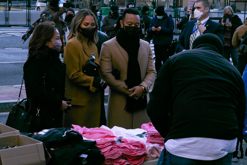 Chrissy Teigan, her mother Vilailuck Teigan and John Legend purchase Biden/Harris memorabilia at Black Lives Matter Plaza near the White House on Inauguration Day