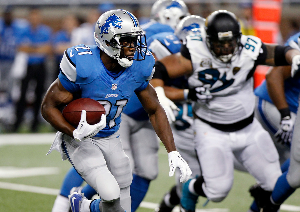 . Detroit Lions running back Reggie Bush (21) runs against the Jacksonville Jaguars in the first half of a preseason NFL football game at Ford Field in Detroit, Friday, Aug. 22, 2014.  (AP Photo/Duane Burleson)