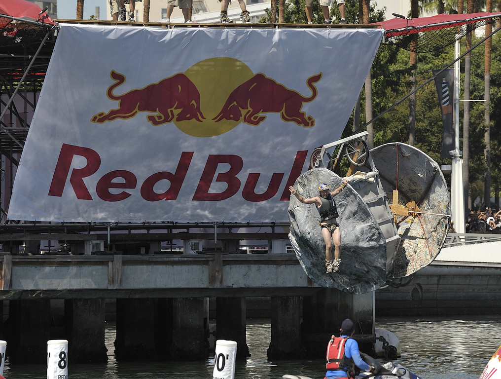 """. LONG BEACH, CALIF. USA -- Jordan Trigg pilots his team\'s Flugtag entry \""""The Flying Rocks!!!\"""" in Rainbow Harbor in Long Beach, Calif. on August 21, 2010. Thirty five teams competed in the Red Bull event where teams build homemade, human-powered flying machines and pilot them off a 30-foot high deck in hopes of achieving flight.  Flugtag means \""""flying day\"""" in German. They are on distance, creativity and showmanship..Photo by Jeff Gritchen / Long Beach Press-Telegram.."""