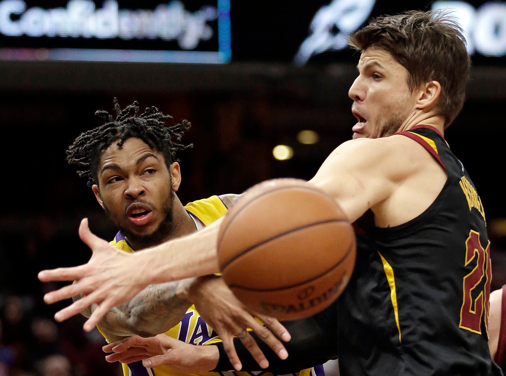 . Los Angeles Lakers\' Brandon Ingram, left, passes around Cleveland Cavaliers\' Kyle Korver in the second half of an NBA basketball game, Thursday, Dec. 14, 2017, in Cleveland. The Cavaliers won 121-112. (AP Photo/Tony Dejak)