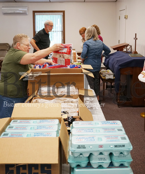Photo by J.W. Johnson Jr.Volunteers prepare items to be distributed at the Southwest Butler Food Cupboard.