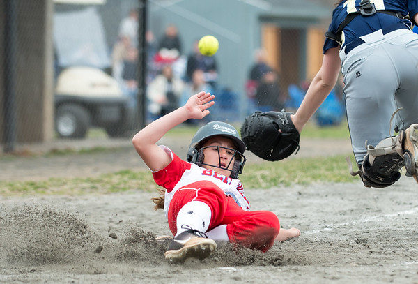 04/12/19 Wesley Bunnell | Staff Berlin softball defeated Platt Tech in an afternoon home game at Sage Park on Friday. Jenna Zup (2) slides safely into home.