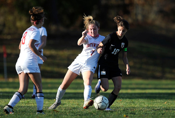 10/23/2019 MIke Orazzi | StaffrTerryville's Amy Roqi (10 ) and Northwestern's Jane Martin (7) during girls soccer at Terryville High School on Wednesday. r