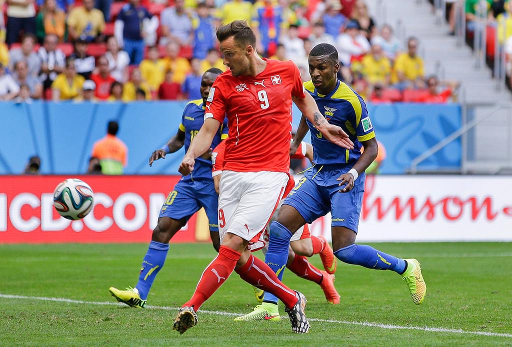. Switzerland\'s Haris Seferovic scores his side\'s second goal during the group E World Cup soccer match between Switzerland and Ecuador at the Estadio Nacional in Brasilia, Brazil, Sunday, June 15, 2014. (AP Photo/Michael Sohn)