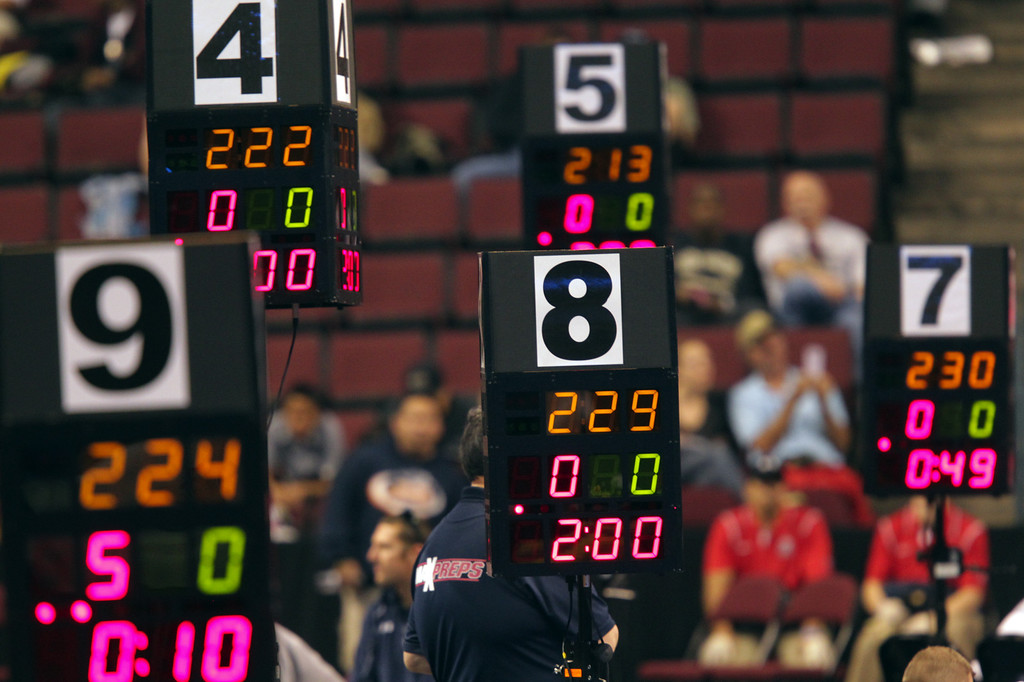 . Scoreboards keep track of the opening rounds during the California Interscholastic Federation wrestling championships in Bakersfield, Calif., on Friday, March 1, 2013. (Anda Chu/Staff)