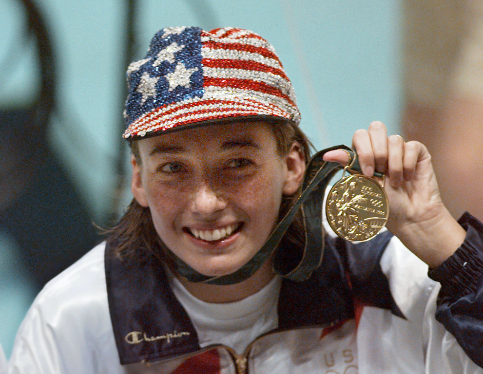 . In this July 26, 1996 file photo, Olympic gold medalist Amy Van Dyken holds her medal after winning the women\'s 50 meter freestyle at the 1996 Summer Olympic Games in Atlanta. (AP Photo/Lynne Sladky, File)