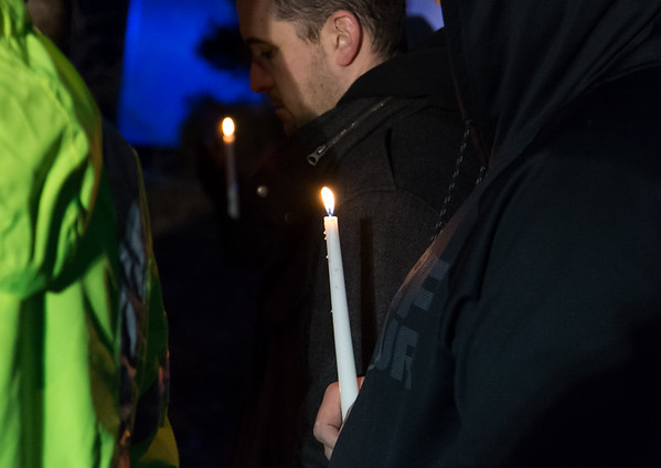 03/01/19 Wesley Bunnell | Staff A candlelight vigil was held on Friday night in front of 73 Elam St where fire claimed the lives of two men, 17 year old Elijah Little and his brother 29 year old Shaheen Davis.
