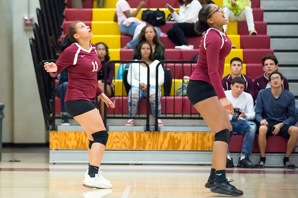 09/16/19 Wesley Bunnell | StaffrrNew Britain volleyball player Nataly Hernandez (11) and Anyerinia Lugo (7) follow the ball.