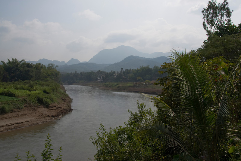 A calm Mekong River on hot day in Luang Prang, Laos