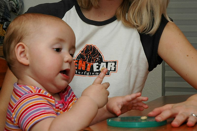 Lily concentrates on keeping the Cheerio stuck to her finger.