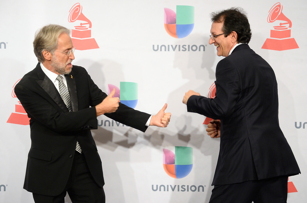 . Neil Portnow, president and CEO of the Recording Academy, left, and Gabriel Abaroa Jr., president and CEO of the Latin Recording Academy, great each other in the press room at the 15th annual Latin Grammy Awards at the MGM Grand Garden Arena on Thursday, Nov. 20, 2014, in Las Vegas. (Photo by Al Powers/Invision/AP)