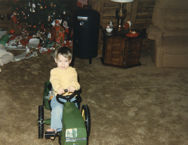 Kyles 1st pedal tractor at  age 3, christmas 1984